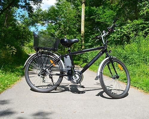 a black electric bike on a path