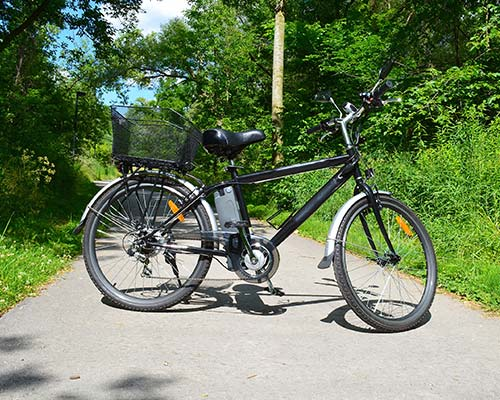 a black electric bike on a path